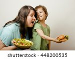 mature woman holding salad and... | Shutterstock . vector #448200535
