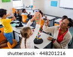 teacher giving lesson to her... | Shutterstock . vector #448201216