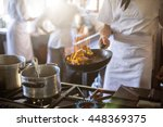 mid section of chef tossing... | Shutterstock . vector #448369375