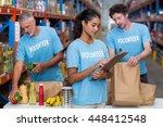 portrait of volunteers working... | Shutterstock . vector #448412548