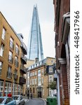 Small photo of LONDON, UNITED KINGDOM - FEBRUARY 20, 2015: The Shard skyscraper with its futuristic glass arrow spire façade form emerging between old classic architecture houses in the city downtown.