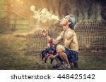 asian man smoking with gamecock ... | Shutterstock . vector #448425142