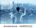 young engineer building city on ... | Shutterstock . vector #448505122