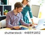 young colleague working from... | Shutterstock . vector #448591852