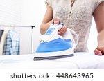 closeup of woman ironing... | Shutterstock . vector #448643965
