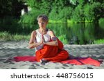 middle aged woman meditating...   Shutterstock . vector #448756015