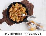 delicious hot potatoes.top view | Shutterstock . vector #448850335