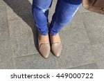 young girl in blue jeans with... | Shutterstock . vector #449000722