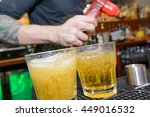 soda being poured at a bar  | Shutterstock . vector #449016532