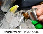 vodka drink being poured  | Shutterstock . vector #449016736