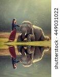 elephant and asian girl  | Shutterstock . vector #449031022