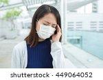 woman feeling unwell   Shutterstock . vector #449064052