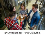 happy brewers toasting beers at ... | Shutterstock . vector #449085256