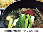 pork on the bone soup in the pot | Shutterstock . vector #449128756