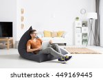 young man relaxing comfortably... | Shutterstock . vector #449169445