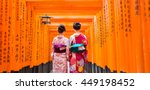 Two Geishas Among Red Wooden...