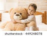 sweet little girl is hugging a... | Shutterstock . vector #449248078