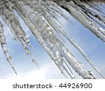 Big Icicles On Sky Background