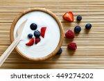 wooden bowl of white yogurt...   Shutterstock . vector #449274202
