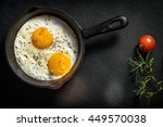 fried eggs in a frying pan with ... | Shutterstock . vector #449570038