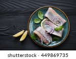 Stock photo top view of fresh herring fillet on a black wooden background 449869735