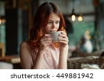 red haired girl in a cafe  ... | Shutterstock . vector #449881942