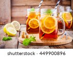 Stock photo ice tea with slice of lemon in mason jar on the wooden rustic background 449900896