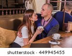 young happy couple drinking... | Shutterstock . vector #449945455