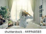 woman stretching in bed after... | Shutterstock . vector #449968585