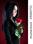 young goth woman with red rose. ... | Shutterstock . vector #45000751