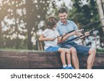 they love fishing together.... | Shutterstock . vector #450042406