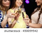 clinking glasses of champagne... | Shutterstock . vector #450059542
