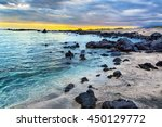 Sunset Over A Rocky Beach On...