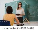 teacher or docent or educator... | Shutterstock . vector #450204982