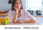 young woman using a tablet... | Shutterstock . vector #450211612