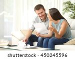 happy couple reading mail and... | Shutterstock . vector #450245596