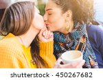 lesbian couple kissing at a... | Shutterstock . vector #450267682