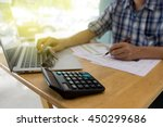 a business man working in home... | Shutterstock . vector #450299686