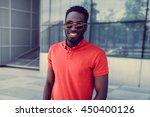 portrait of smiling african... | Shutterstock . vector #450400126