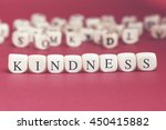 kindness word written on wood... | Shutterstock . vector #450415882
