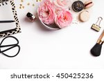 Stock photo beautiful pink flowers french macarons notepad and other cute feminine stuff on white background 450425236