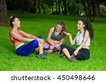 three cheerful sportswomen... | Shutterstock . vector #450498646