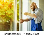 windows installation worker. | Shutterstock . vector #450527125