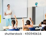 happy female teacher looking at ... | Shutterstock . vector #450540616