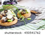 crostini with fish with olives  ... | Shutterstock . vector #450541762