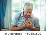 senior man suffering from chest ... | Shutterstock . vector #450551602
