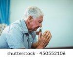 Worried Senior Man Sitting In...