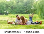 couple lying on a picnic... | Shutterstock . vector #450561586