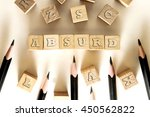 Small photo of ABSURD word written on building block concept