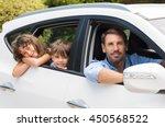 children sitting in the car... | Shutterstock . vector #450568522